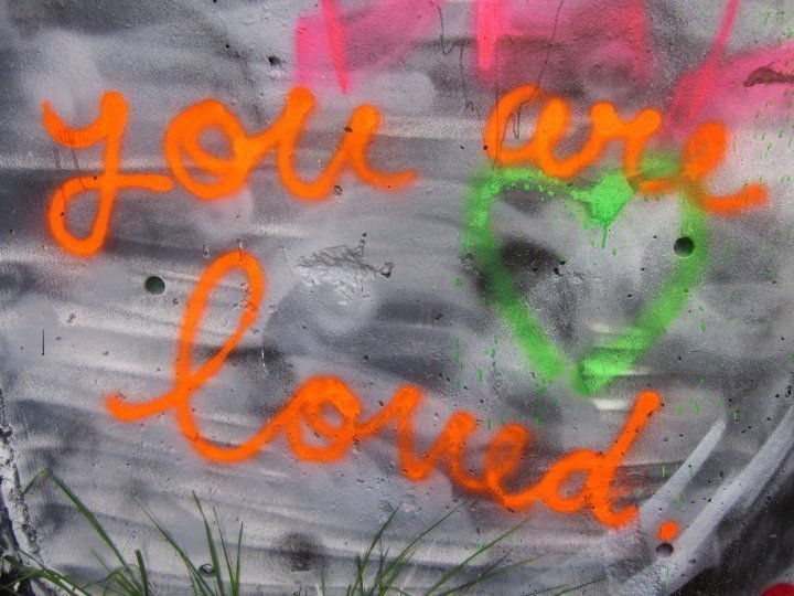 """Graffiti wall Austin Texas - just reminding you that """"you are loved"""""""