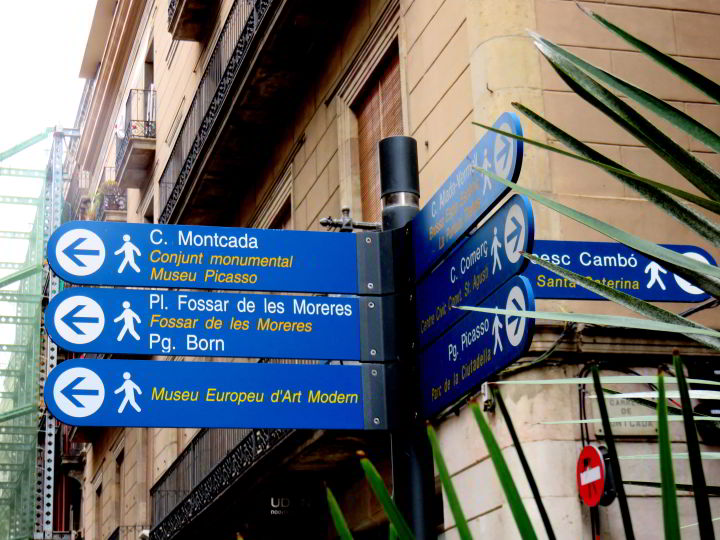 Getting Around in Barcelona - blue signs point the way to popular tourist sites all around the city