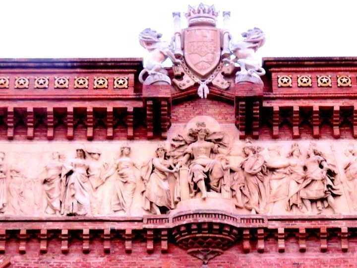 Stone frieze and red brick - Arc de Triomf in Barcelona