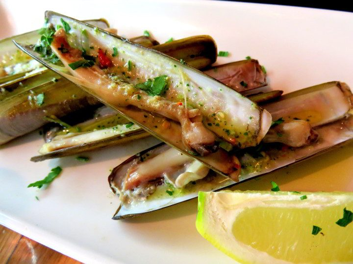 Tapas in Barri Gotic district of Barcelona - navalles (razor clams) with lemon - delicious treat at Taller de Tapas in Barcelona