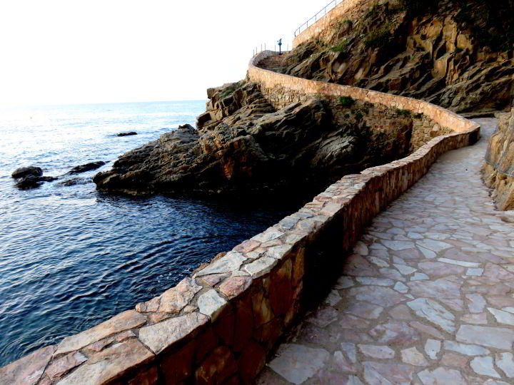 Stone path along the Costa Brava hiking trail in Lloret de Mar Catalonia coast - part of the GR92 foot path route