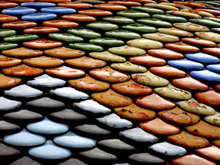 Roof tiles atop Sant Roma church in Lloret de Mar Costa Brava Catalonia Spain