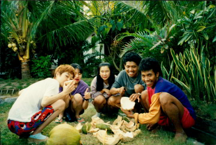 Three Japanese tourists and two local Indonesians enjoying fresh cut coconut - Candidasa Bali Indonesia - 1993