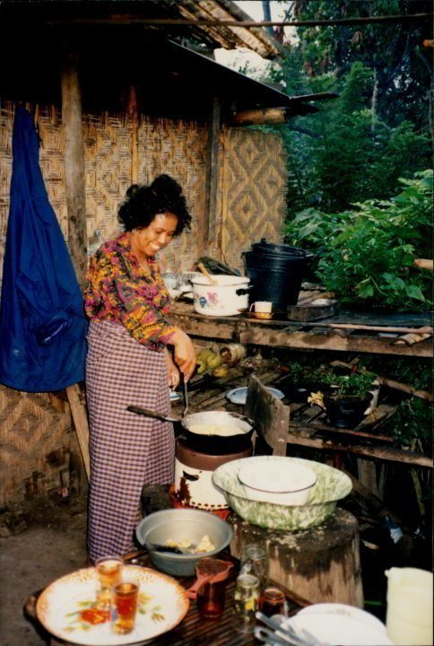 Amina Moi making pancakes at her guesthouse in Moni - visiting the island of Flores Indonesia in 1993