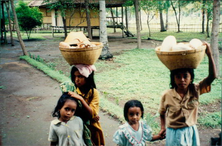 Four young girls with baskets of seashells - at Gili Air, a small island near Lombok Indonesia
