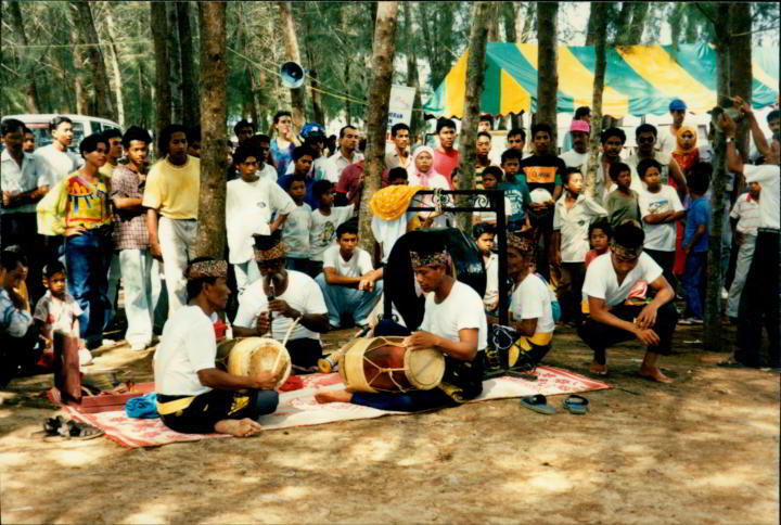 Musicians performing at kite festival in Malacca Malaysia in 1993