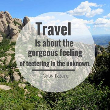 Gaby Basora quote - Travel is about the gorgeous feeling of teetering in the unknown - Montserrat Catalonia in background
