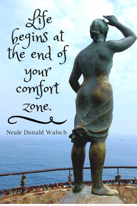 Fisherman's Wife statue by Ernest Maragall - woman looking out to sea at Lloret de Mar in Costa Brava. Inspirational travel quote by Neale Donald Walsch: Life begins at the end of your comfort zone