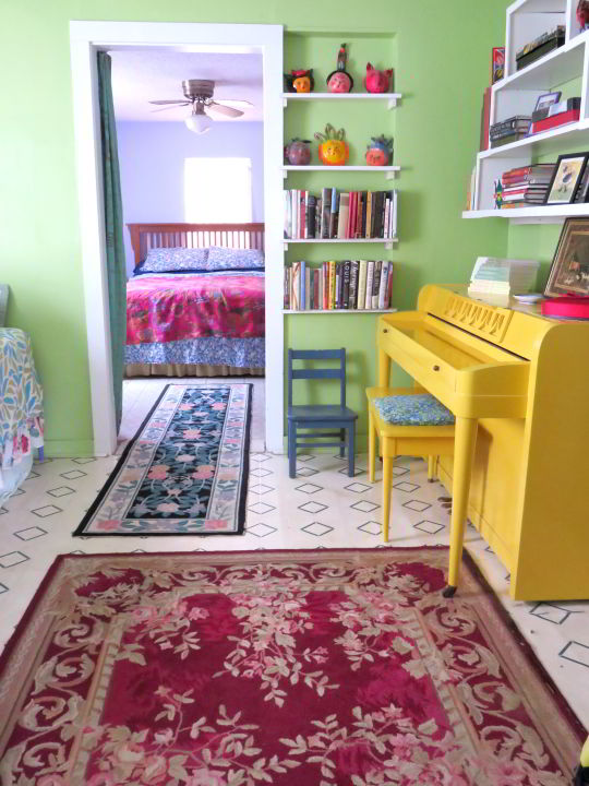 Airbnb rental in Alpine TX with yellow piano in the spare room, bedroom in the back of the house - colorful decor!