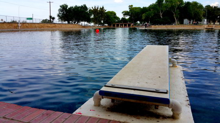 View from the diving board looking out to San Solomon Springs swimming pool in Balmorhea State Park in west Texas