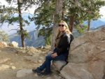 Solo female travel - modern nomad Susan Moore posing for a photo at Mt San Jacinto State Park