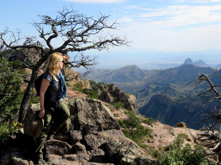 Solo female travel - Susan Moore looks out to the panoramic mountain view along her favorite hike at Big Bend National Par, the Lost Mine Trail, in Texas USA
