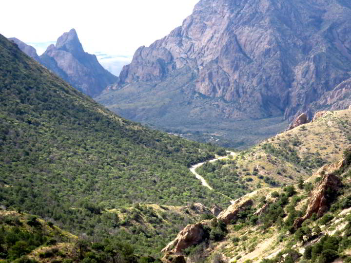 Photo taken from Lost Mine Trail wiht a zoom lens showing the view of Window Trail - a v-shape window in the mountains at Big Bend National Park in West Texas