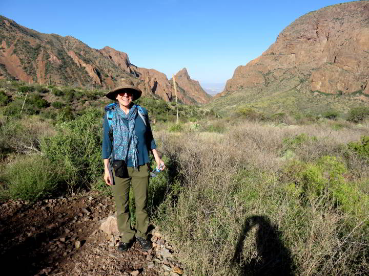 Susan Moore in foreground - v-shape window in the mountains at Big Bend National Park - Window Trail hiking trail