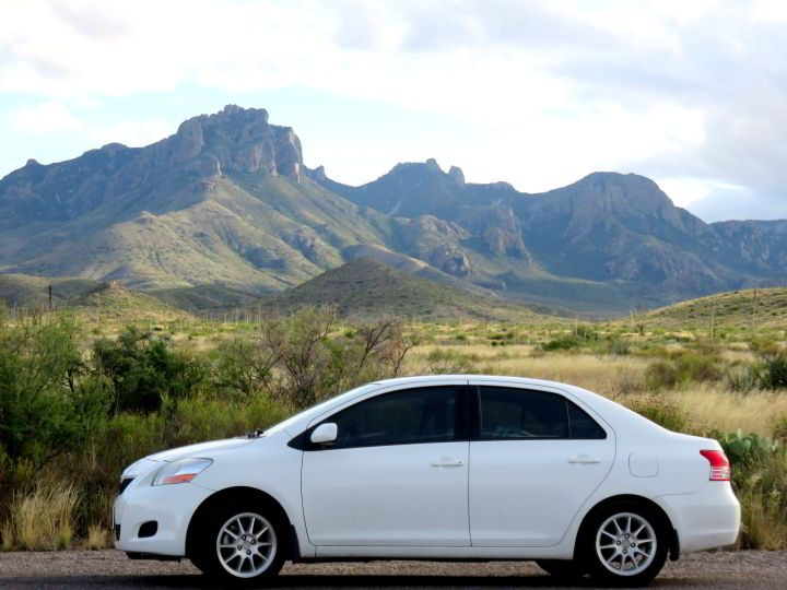 Road trip in White 2009 Toyota Yaris sedan in Big Bend National Park