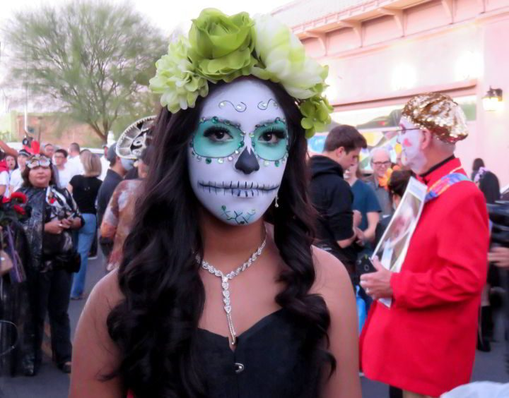 Woman with painted face for All Souls Procession event in Tucson AZ