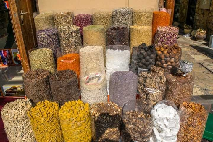 Colorful spices on display at Dubai gold and spice souk in the Deira neighborhood