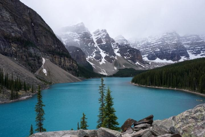 Solo road trip to turquoise color Moraine Lake surrounded by mountains in Banff National Park Alberta Canada