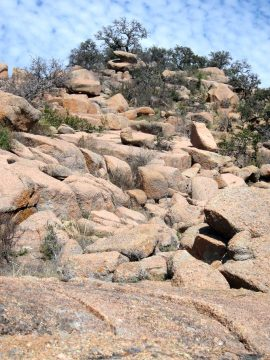 Enchanted Rock State Park hike on a granite boulder