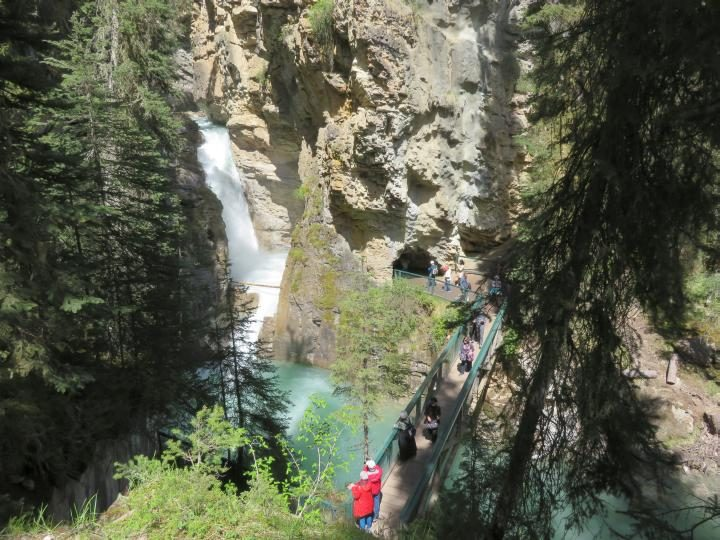 Tourists visiting Lower Falls at Johnston Canyon Banff, one of the most popular hikes