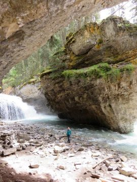 Secret hiking trail leads to scenic waterfall and hidden cave in Johnston Canyon Banff