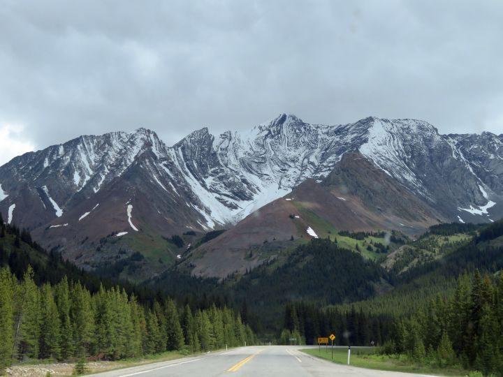 Road trip view of Rockies on Alberta Hwy 40 in Kananaskis Country Canada