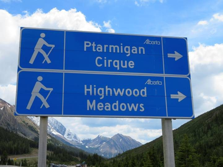 Signage for Ptarmigan Cirque and HIghwood Meadows hiking trails in Kananaskis Alberta