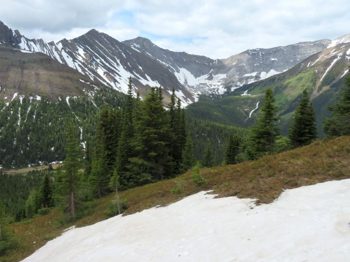 Snow along Ptarmigan Cirque trail with views of the Rocky Mountains in Kananaskis AB