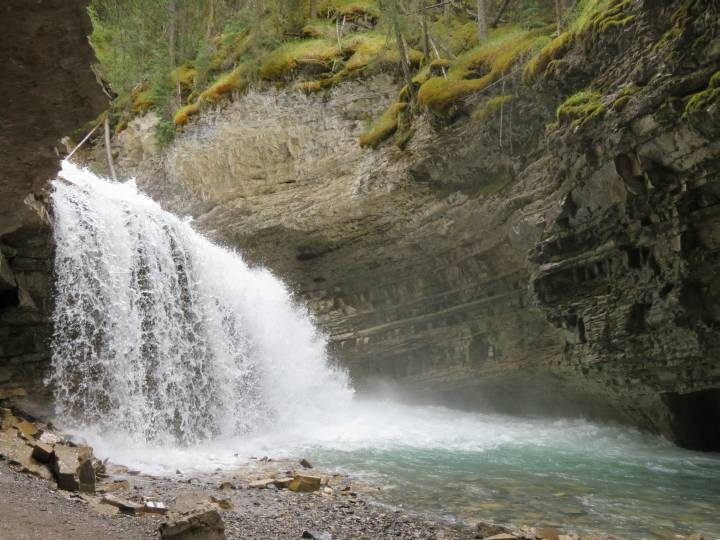 Waterfall and hidden cave at Johnston Canyon can be found along secret trail