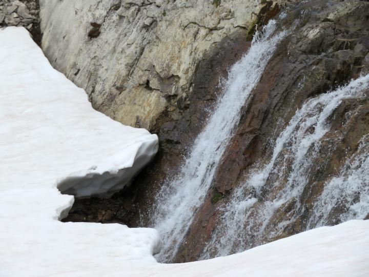 Waterfall and snow on Ptarmigan Cirque trail in Kananaskis Country Alberta