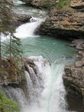 Johnston Canyon hike along the Johnston Creek includes small waterfalls leading to the lower and upper falls