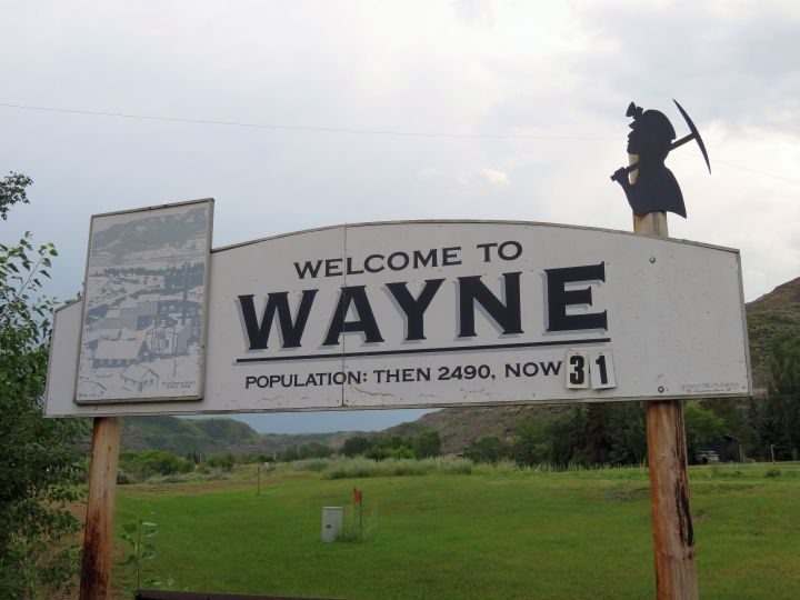 Sign welcomes visitors to Wayne Alberta, former mining town - population then 2,490, now 31