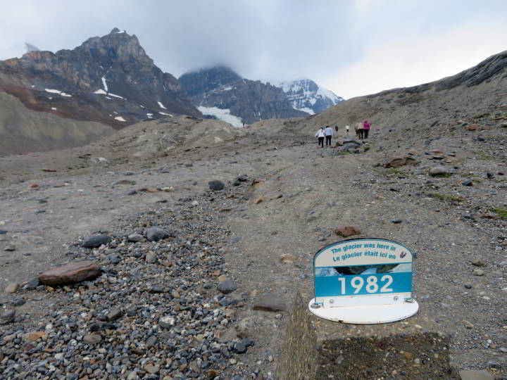 1982 marker on the Toe of the Athabasca Glacier hiking trail marks where the glacier used to reach to on the mountain.