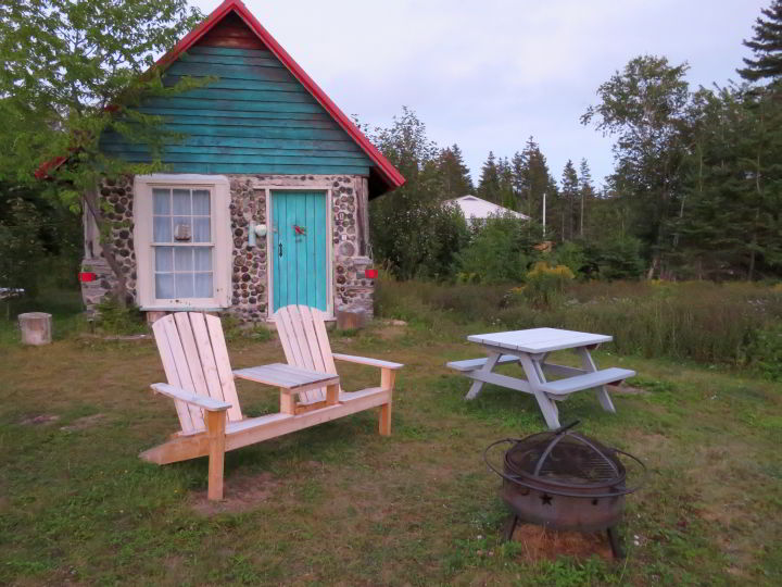 Ingonish Cabot Trail cottage rental with front yard seating and fire pit