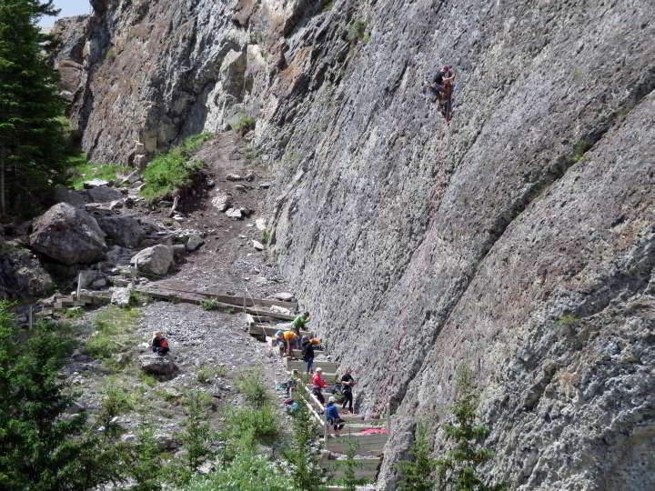 Rock climbers at Grassi Lakes rock climbing area in summer at Kananaskis Alberta