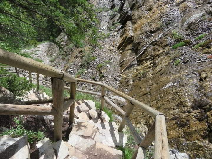 Staircase beside the waterfall at Grassi Lakes hiking trail Kananaskis