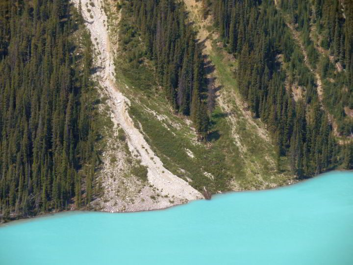 Spring thaw brings snow melt and rock debris down into Peyto Lake
