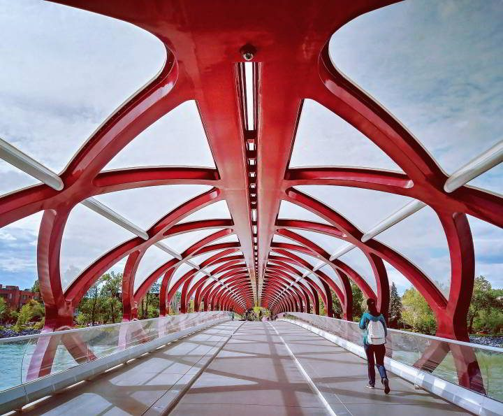 Bright red skeleton of the Peace Bridge which connects pedestrians to downtown Calgary. Designed by Spanish architect Santiago Calatrava