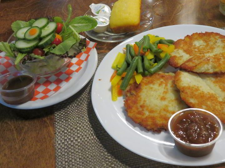 Feasting on fish cakes with veggies, dinner salad, and cornbread at Creekview Restaurant in Gagetown NB