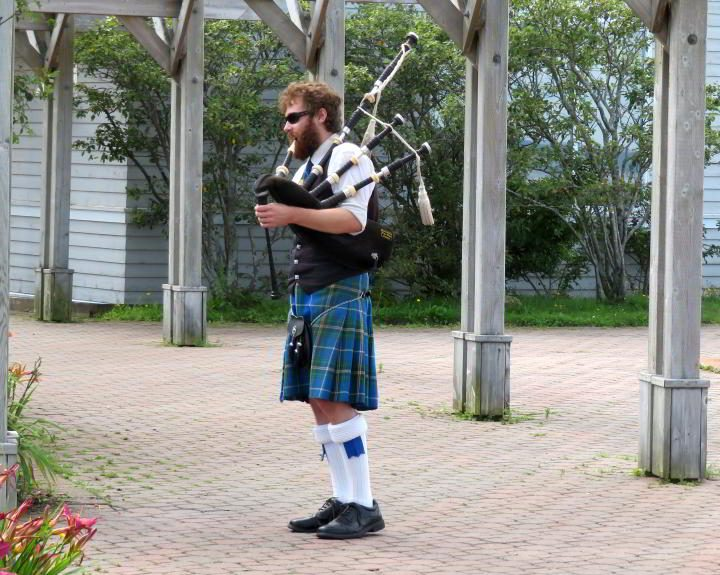 Greeting travelers at the visitor center in Nova Scotia, a bagpiper in a kilt
