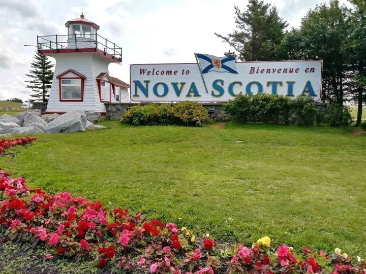 This small replica lighthouse next to the Welcome to Nova Scotia sign greets travelers entering Nova Scotia from New Brunswick Canada