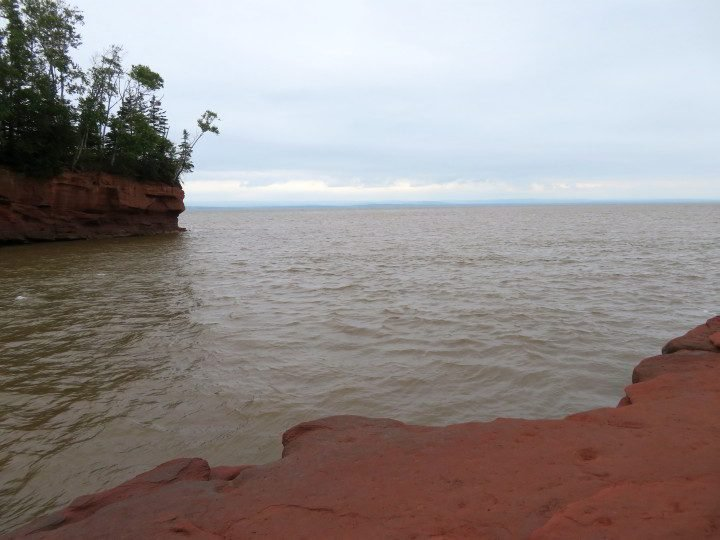 Flowerpot on the left is surrounded by water at high tide Bay of Fundy