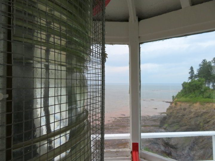Fresnel lens at Walton Lighthouse and view of low tide