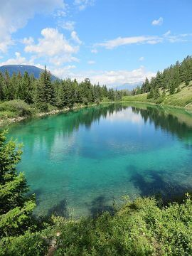 Crystal clear glacier lake at Valley of the Five Lakes in Jasper Alberta