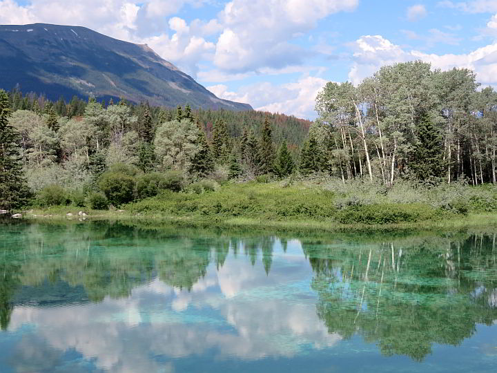 Glacial lake reflects the landscape of Jasper AB Canada