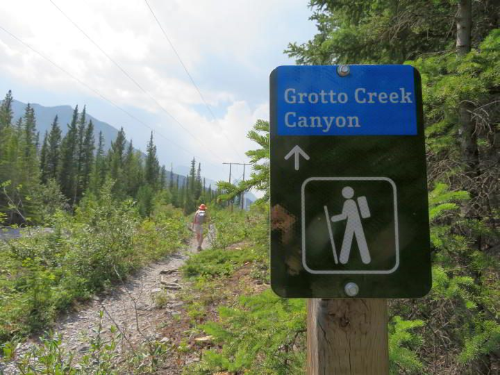 Hiker and signage for Grotto Creek Canyon
