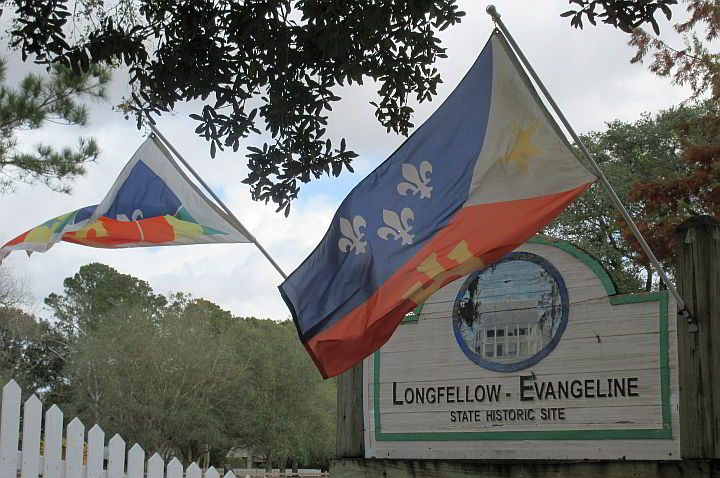 Flags wave at the entrance to Longfellow Evangeline State Historic Site in St Martinville LA
