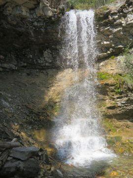 A beautiful waterfall is the reward at Troll Falls trail in Kananaskis Village AB