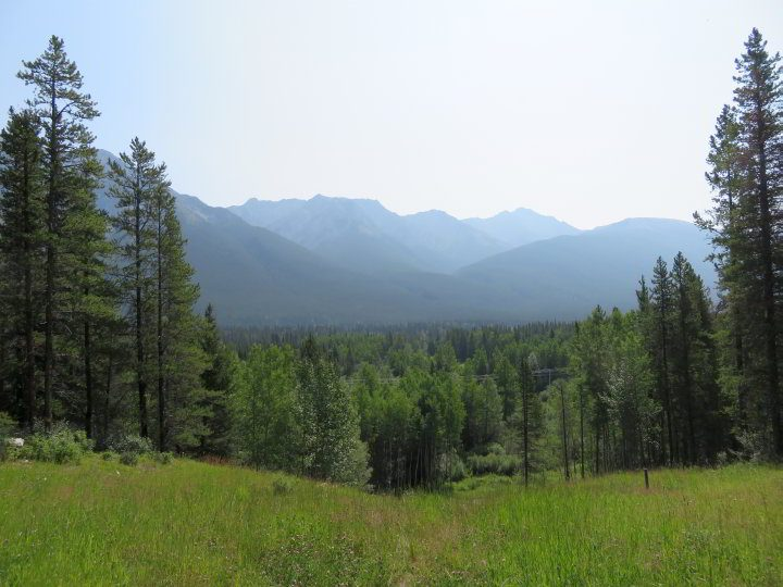 Mountains and meadows along the hiking trail at Troll Falls in Alberta