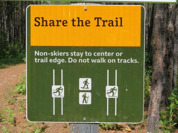 Signs remind hikers to stay off the ski tracks during winter hikes at Troll Falls